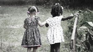 Supporting children's mental health. A photo of Two young girls holding hands