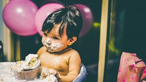 Childhood obesity Thought Piece. A photo of a baby eating a cake.