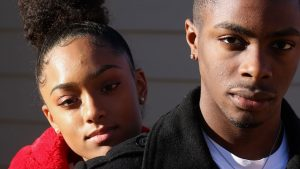 Marginalised, stigmatised and excluded Thought Piece. A photo of a young couple looking into the camera with serious expressions