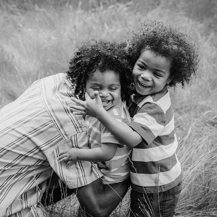 Two children playing with dad